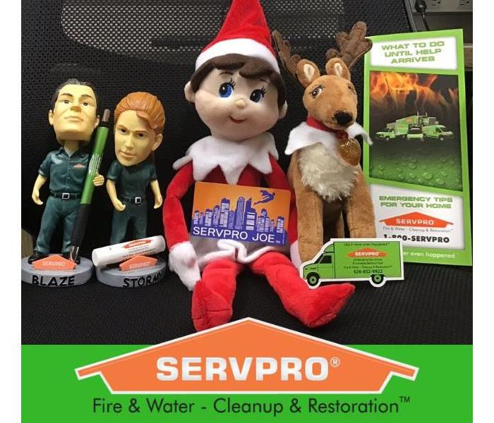 Dolls and Figures Depicting SERVPRO at a Trade Show